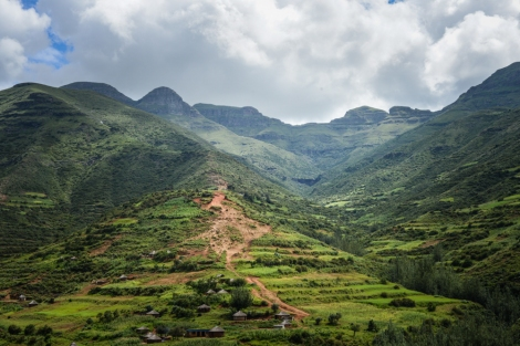 A village and a mountain road in the Lesotho highlands, en route to Mokhotlong | © Meri Hyöky Photography
