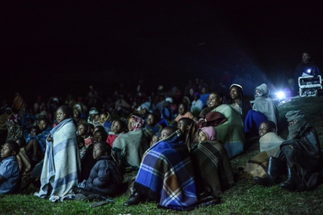 First time at the cinema! Children watch in amazement at the screening in Mokhotlong | © Meri Hyöky Photography