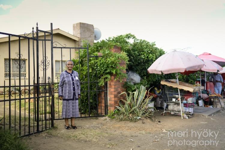 Mosala outside her home in Maseru.